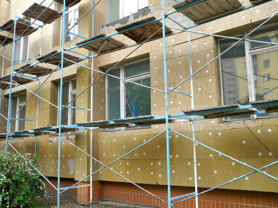 external insulation on building with scaffolding