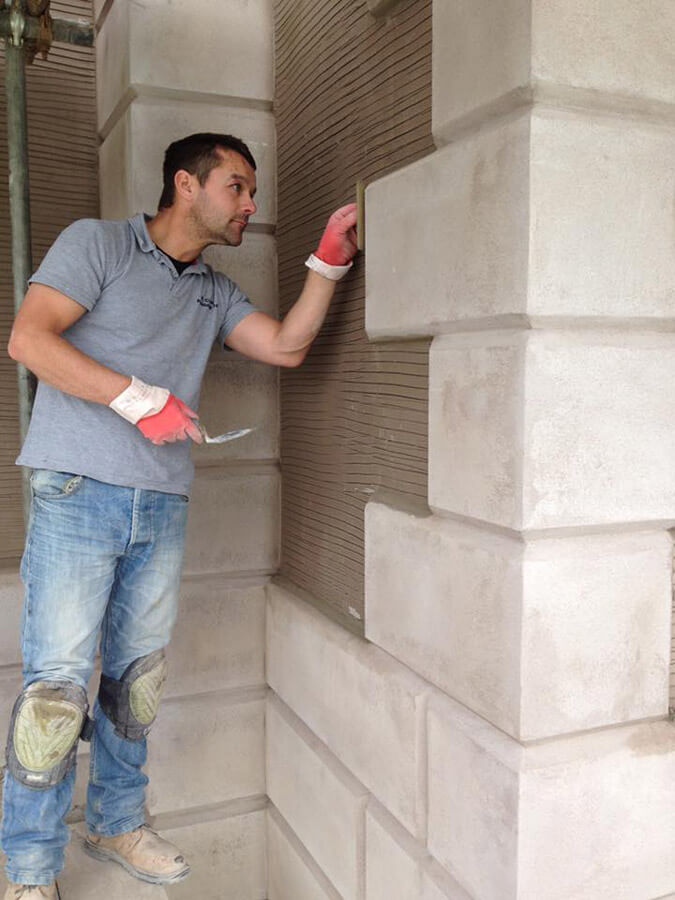 person doing detailed cement work