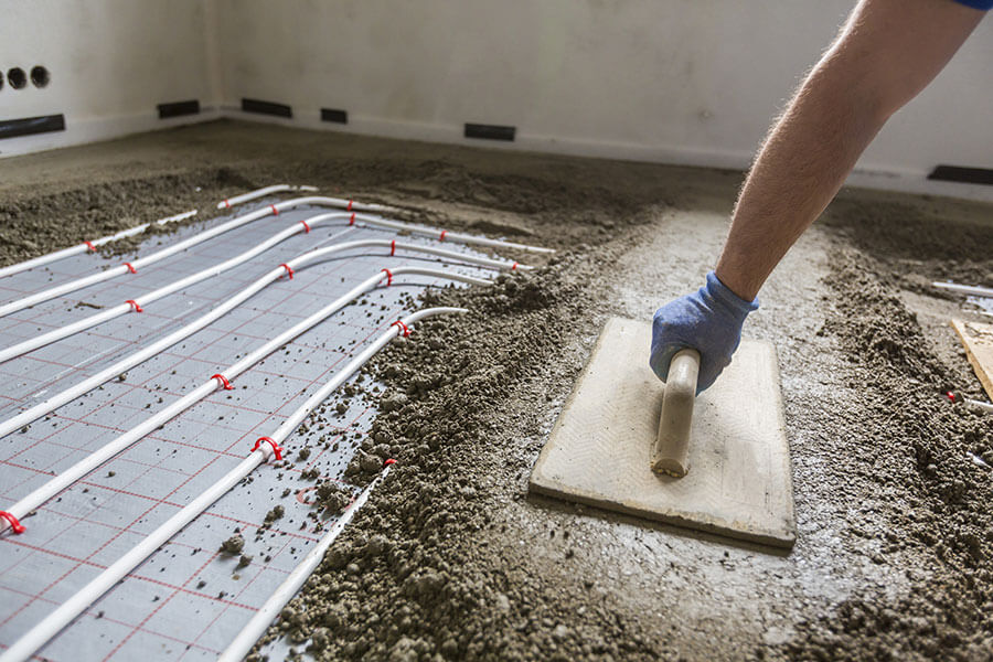 screed-being-applied-to-floor